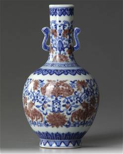 A BLUE AND WHITE AND IRON-RED DECORATED 'BAT VASE,
