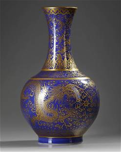A CHINESE POWDER BLUE AND GILT BOTTLE VASE, QING