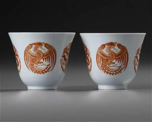 A PAIR OF CHINESE IRON-RED 'DRAGON AND PHOENIX' CUPS