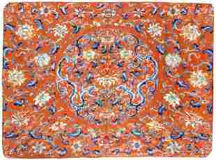 A CHINESE EMBROIDERED SILK PANEL DECORATED WITH DRAGONS