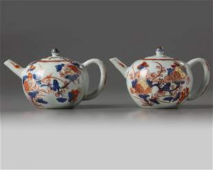 A PAIR OF CHINESE IMARI 'FLORAL' TEAPOTS AND COVERS,