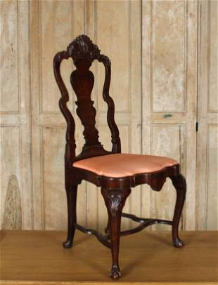 An 18th C. Iberian Baroque Style Carved Side Chair