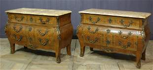 A Pair of French Louis XV Style Commodes
