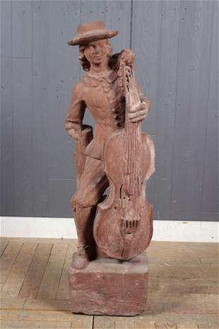 Carved Stone Figural Cellist