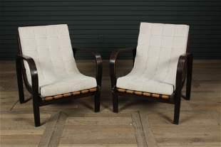 A Pair of Kozelka & Kropacek MCM Arm Chairs