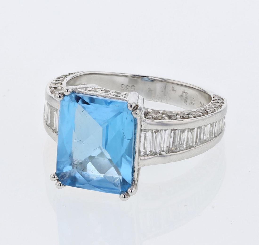 14KT White Gold 4.07ct Blue Topaz and Diamond Ring
