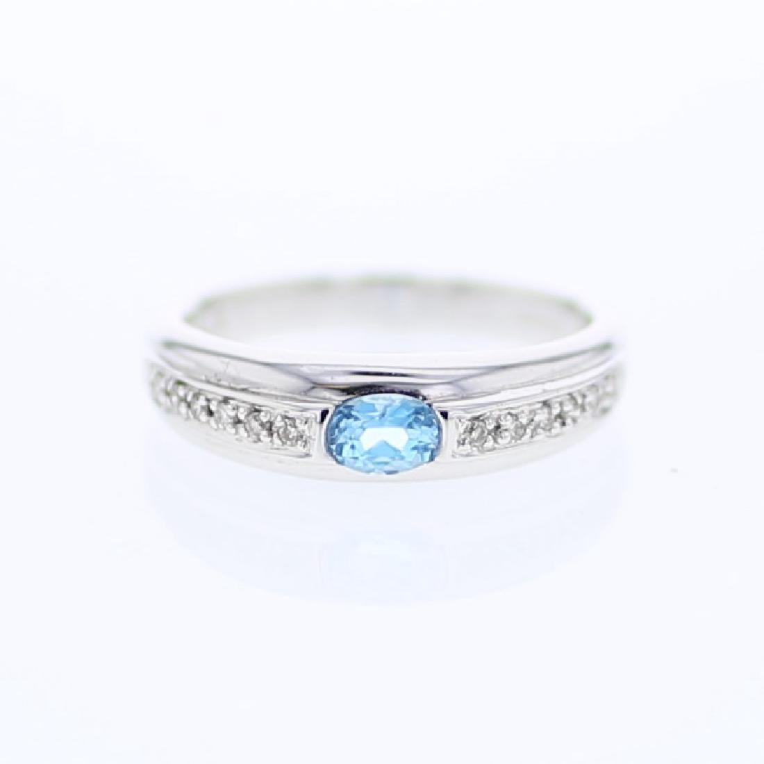 14KT White Gold 0.34ct Blue Topaz and Diamond Ring