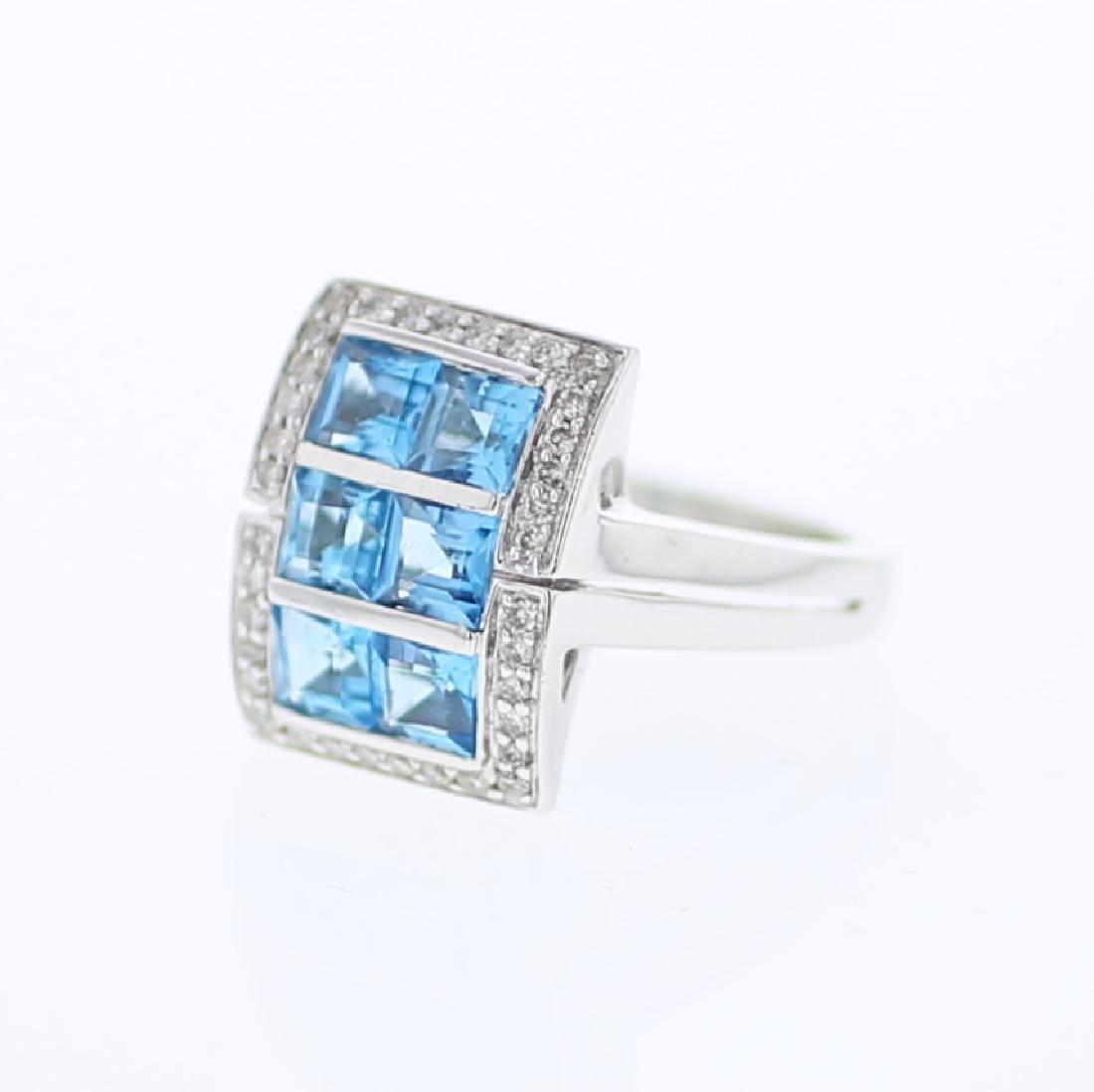 14KT White Gold 2.54ctw Blue Topaz and Diamond Ring