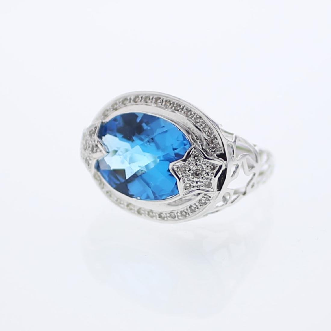 14KT White Gold 10.70ct Blue Topaz and Diamond Ring