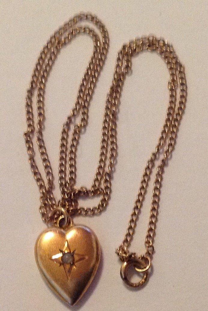 Estate vintage 10k gold heart child pendant necklace