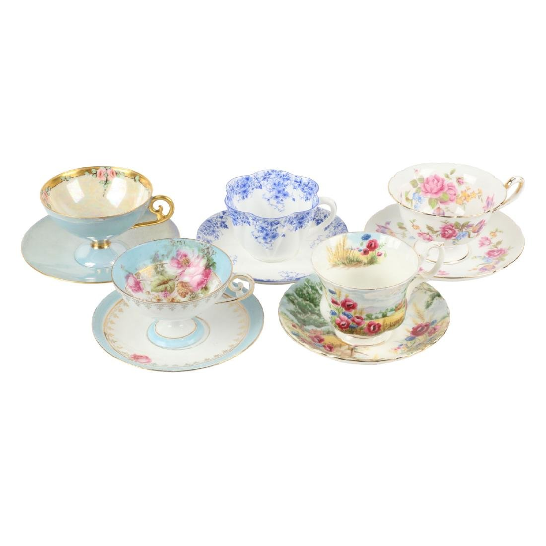 Twenty-two (22) sets of Tea Cups & Saucers