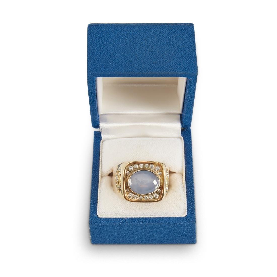 A Gent's 18k Gold, Diamond & Star Sapphire Ring