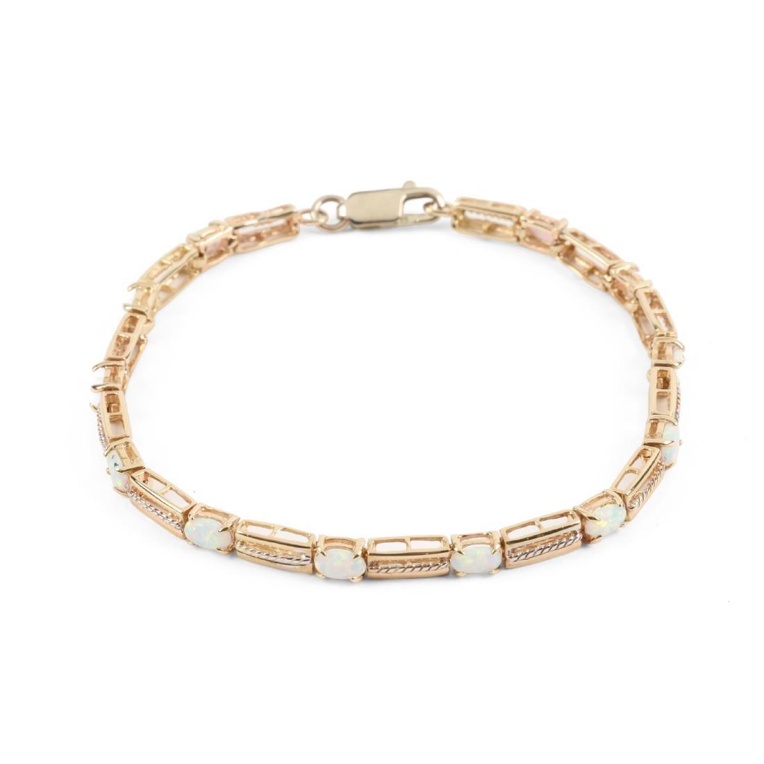 A 14K Yellow Gold, Opal Bracelet