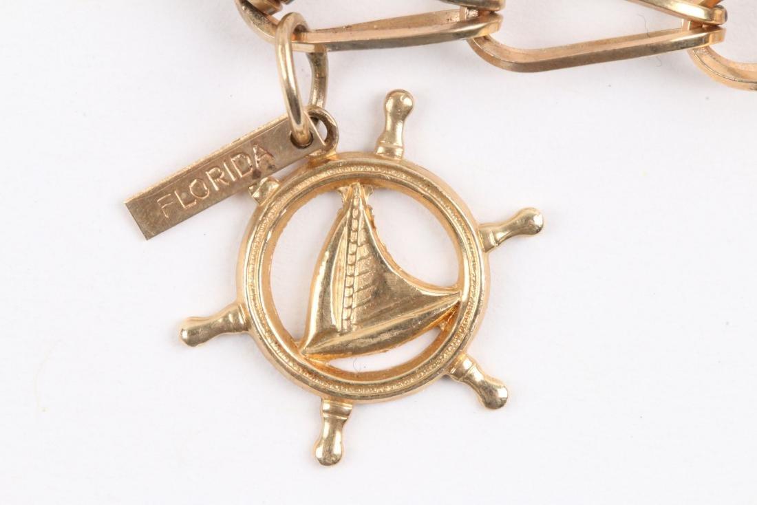 A 10K Gold Charm Bracelet - 2