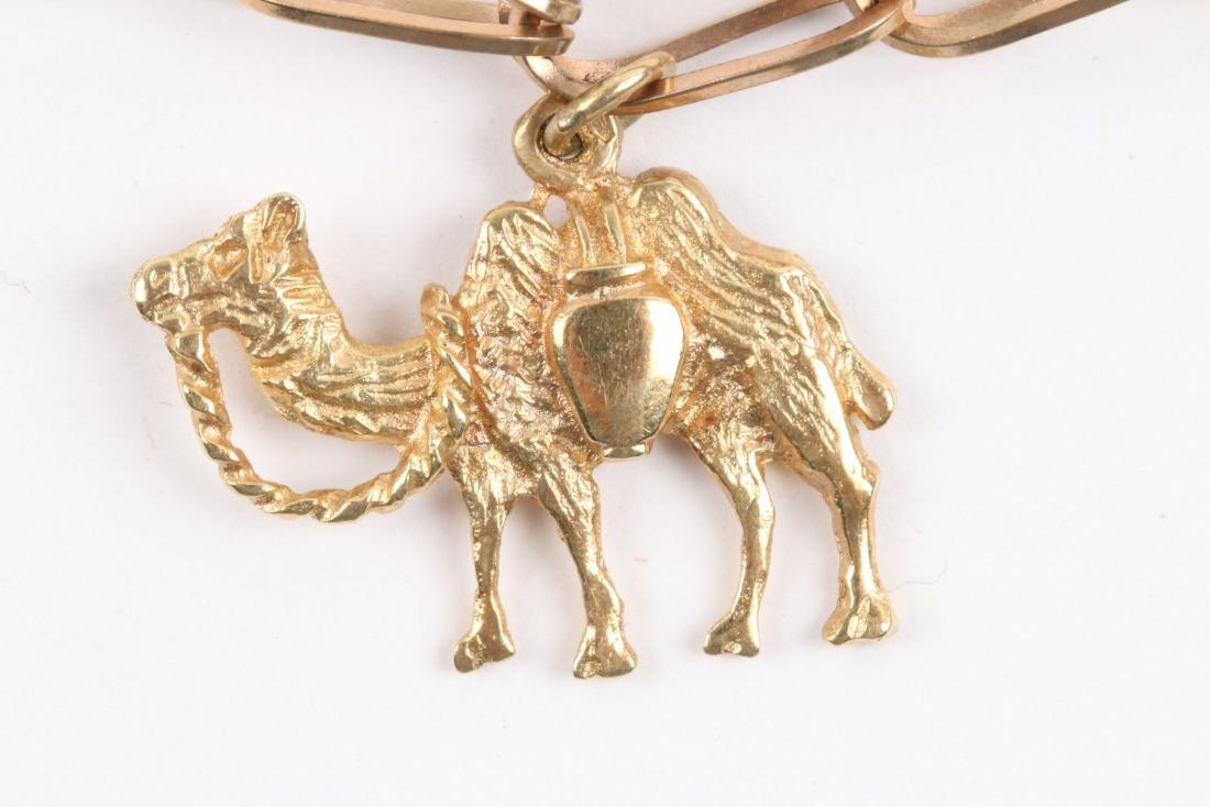 A 10K Gold Charm Bracelet - 3