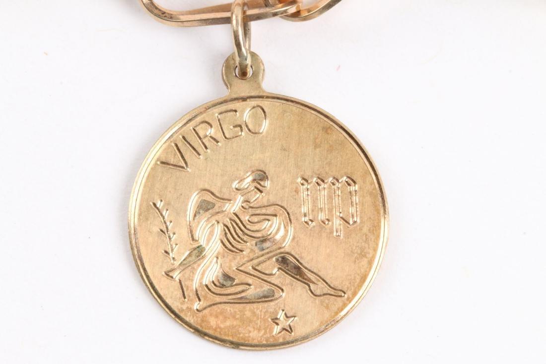 A 10K Gold Charm Bracelet - 4