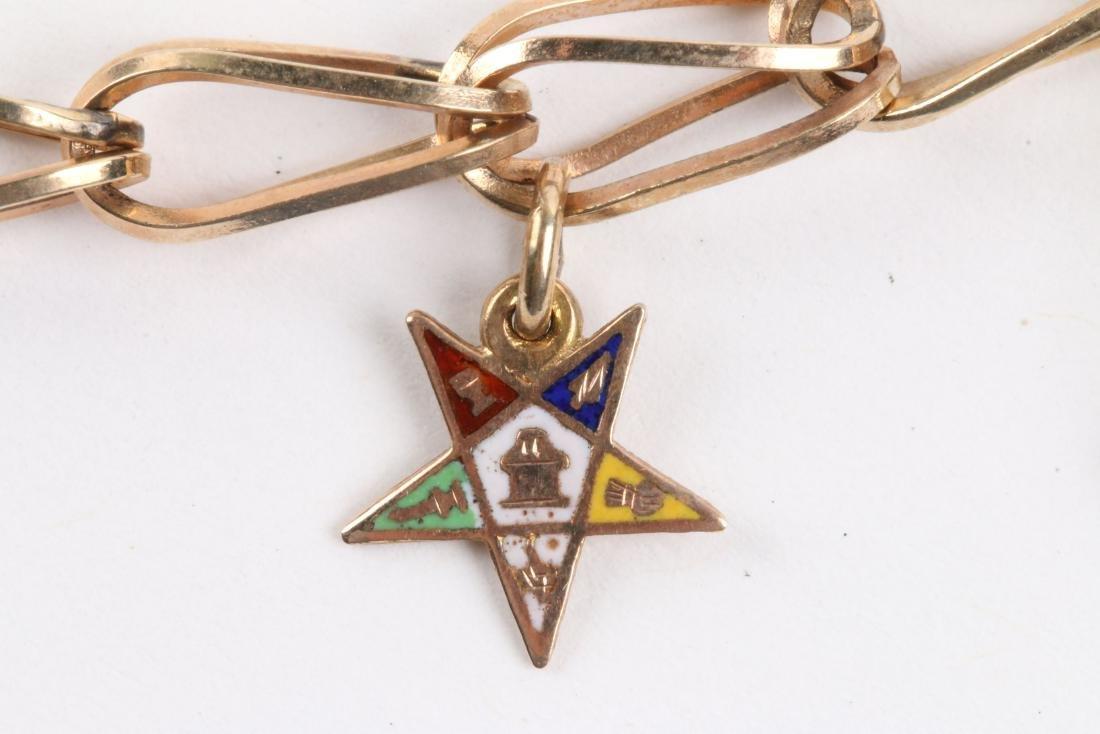 A 10K Gold Charm Bracelet - 5