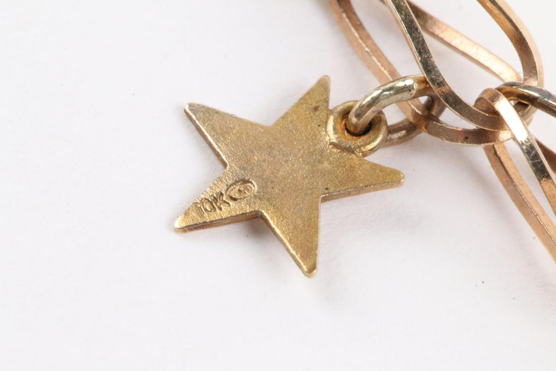 A 10K Gold Charm Bracelet - 6