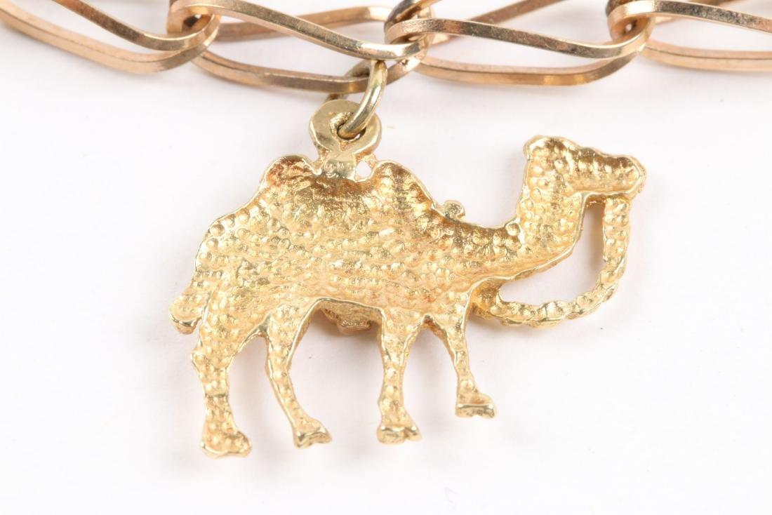 A 10K Gold Charm Bracelet - 8