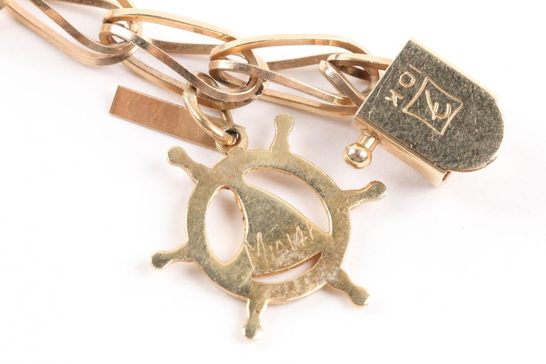 A 10K Gold Charm Bracelet - 9