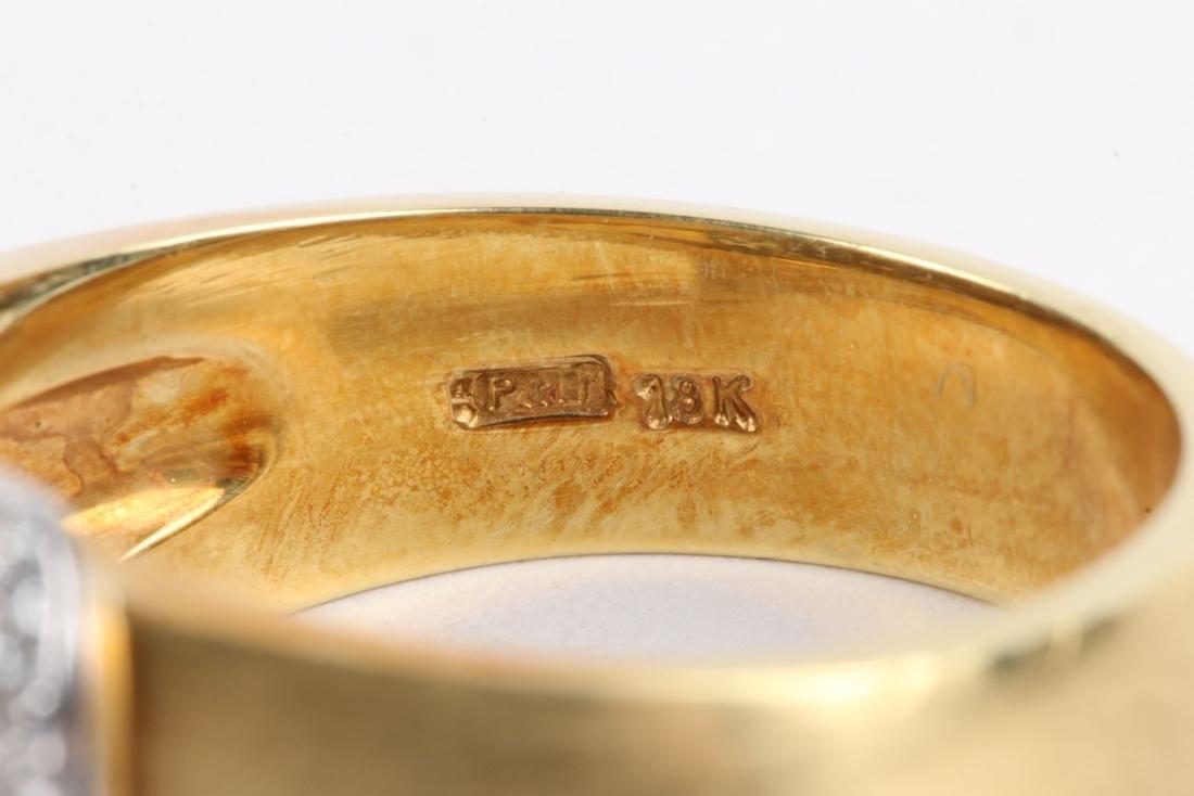 An 18K Gold & Diamond Ring - 8
