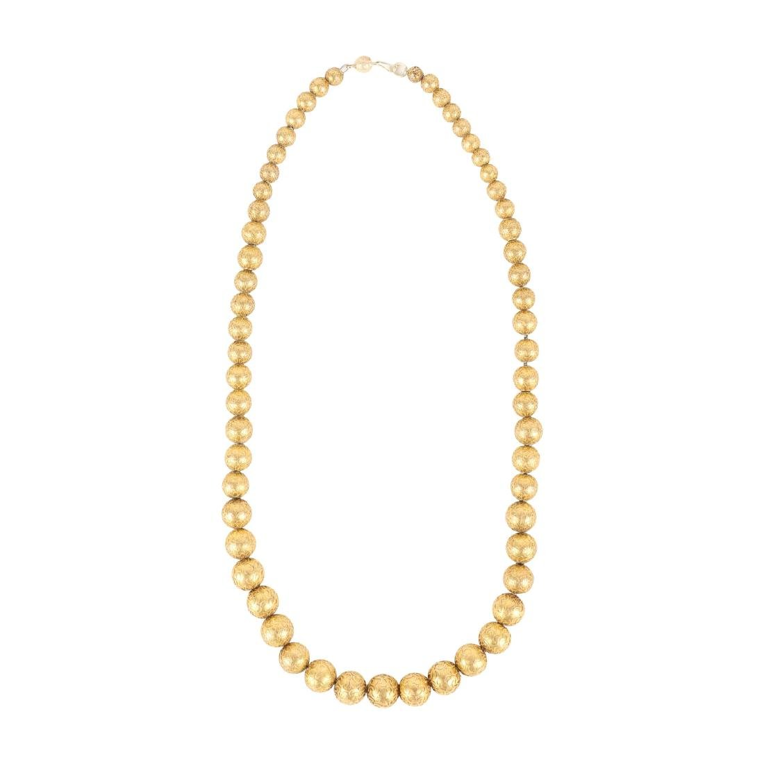 An 18K Yellow Gold Necklace