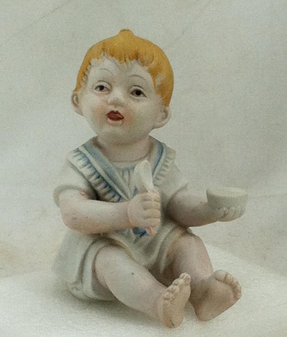Bisuqe Red-Headed Baby Boy Figurine