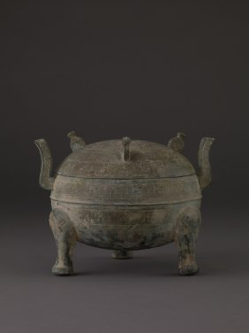 A BRONZE COVERED VESSEL, DING