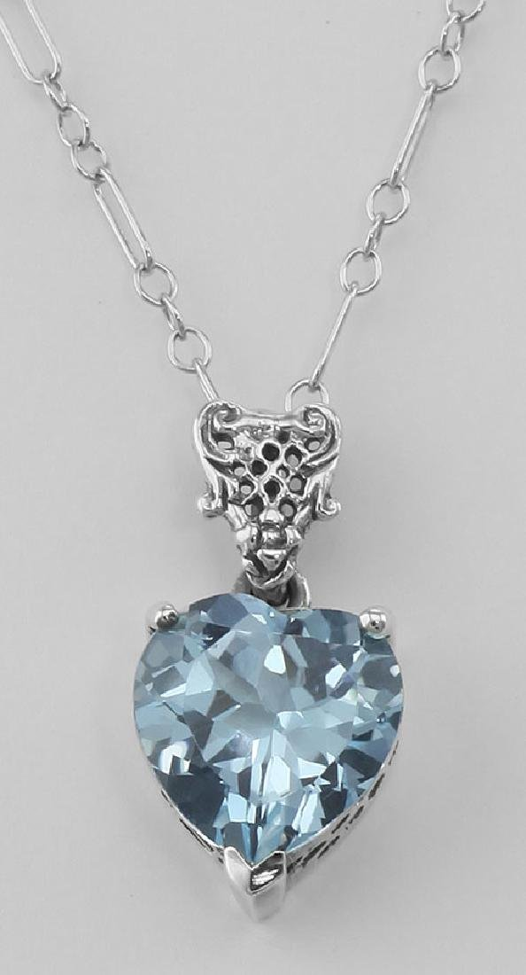Filigree Heart Shaped Blue Topaz Pendant - Sterling Sil