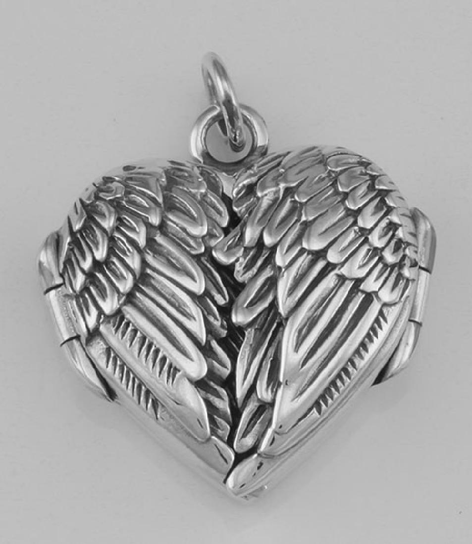 Beautiful Angel Wings Heart Locket In Fine Sterling Sil
