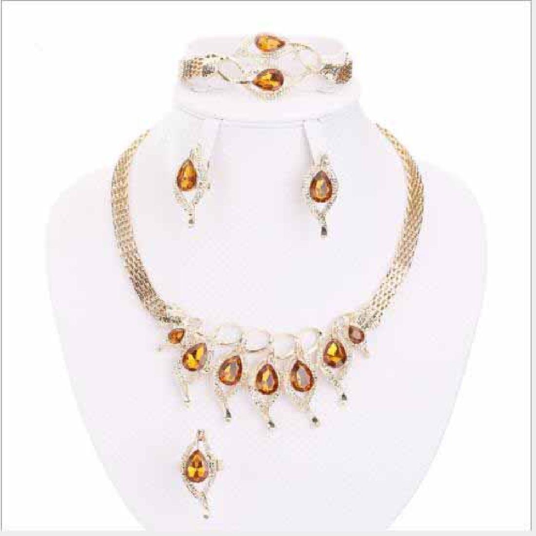 CREATED ORANGE SAPPHIRE & CREATED DIAMOND 18K GOLD PLAT