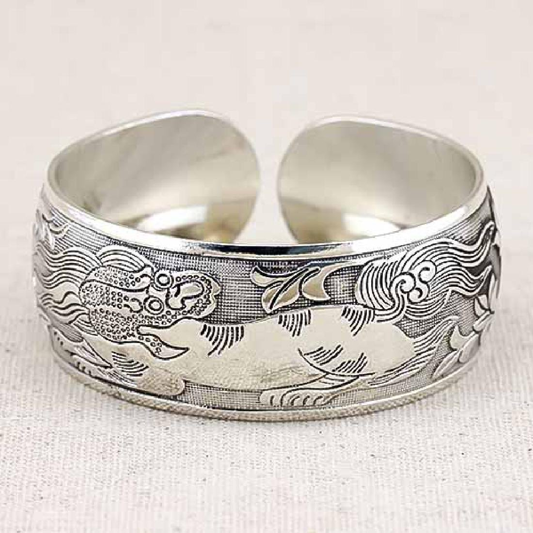 ANTIQUE SILVER ADJUSTABLE KYLIN BANGLE