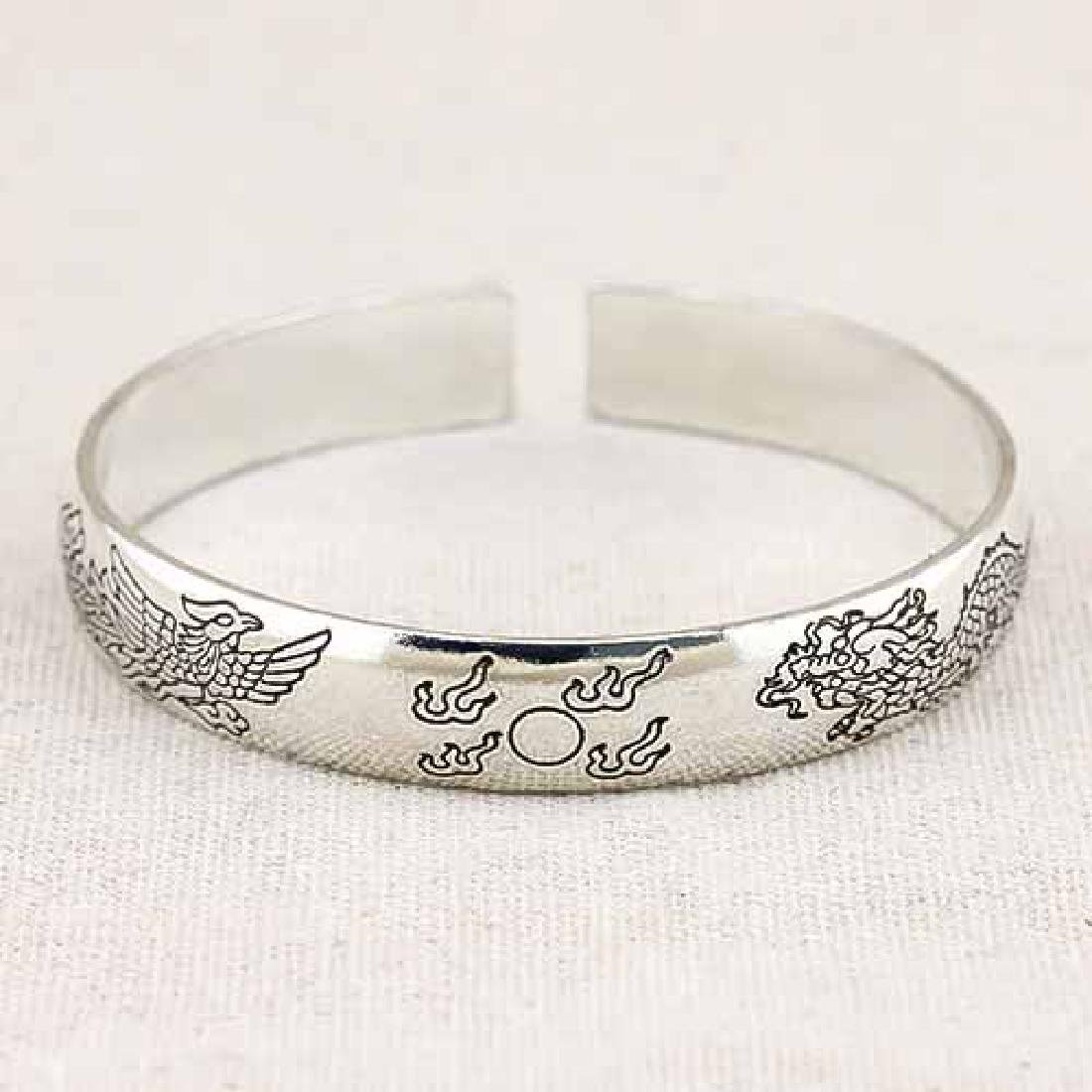 ANTIQUE SILVER ADJUSTABLE DRAGON AND PHOENIX BANGLE