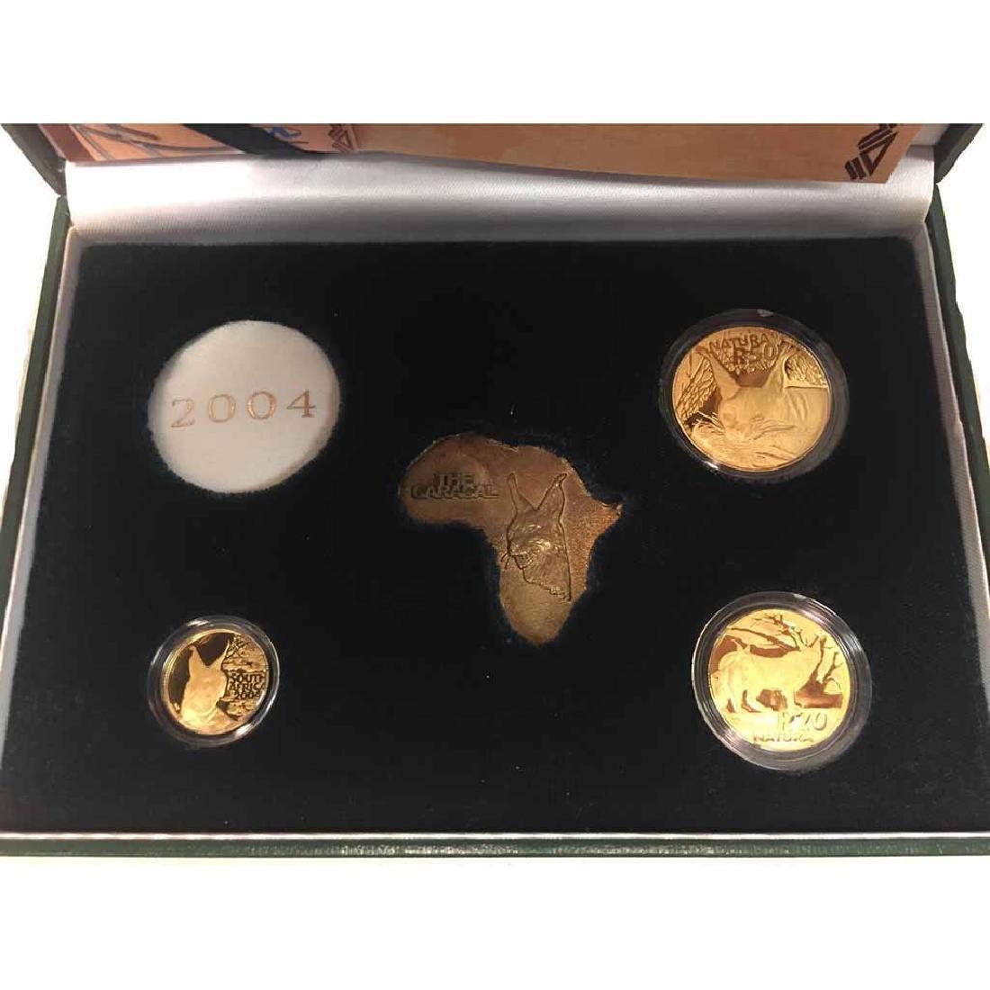 South Africa 3 piece gold Natura set 2004 Caracal
