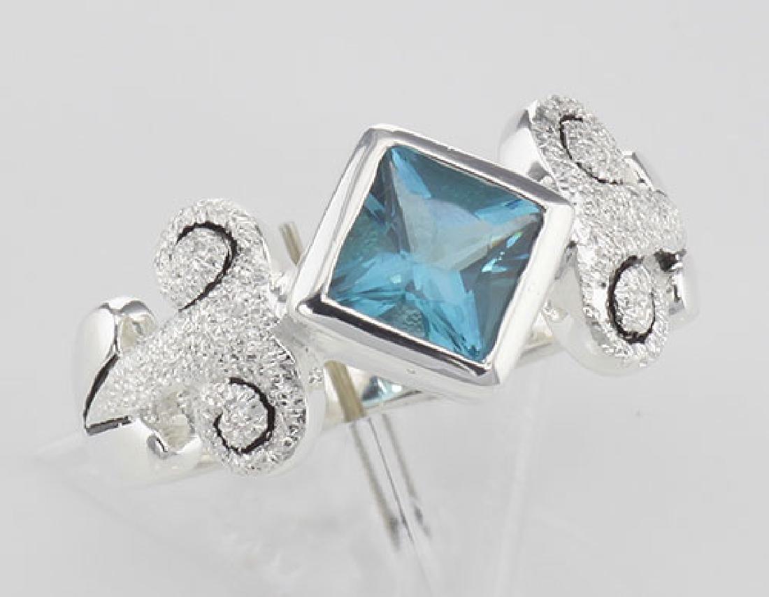 Stunning Genuine Princess Cut Blue Topaz Ring - Sterlin