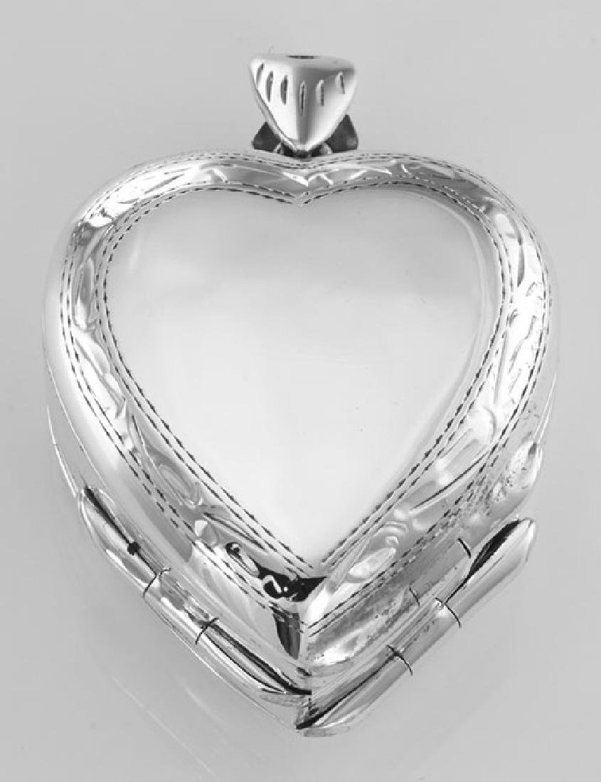 Sterling Silver Heart Locket with Border Design - 4 Pho