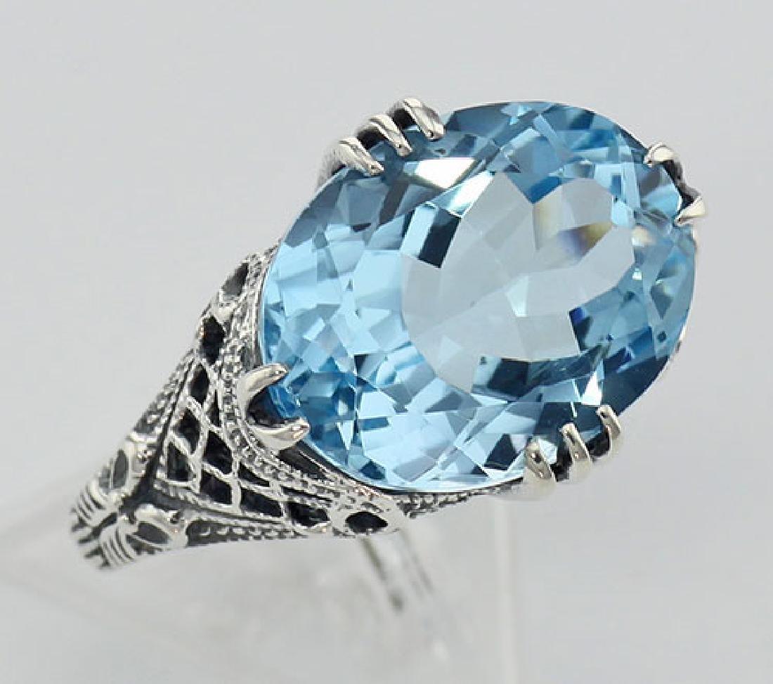 8.9 Carat Geniune Blue Topaz Filigree Ring - Sterling S