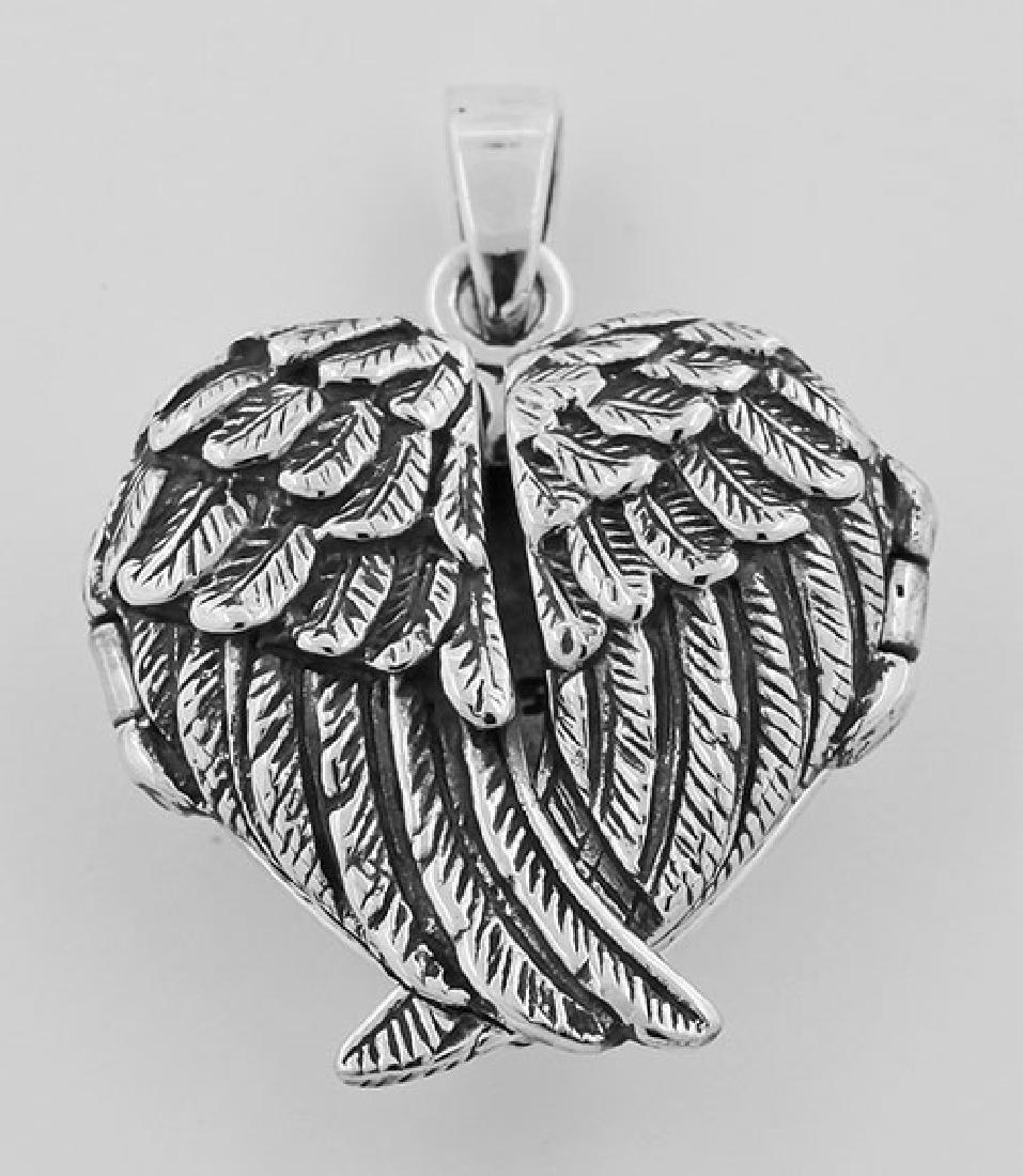Beautiful Wrapped Angel Wings Heart Locket Sterling Sil