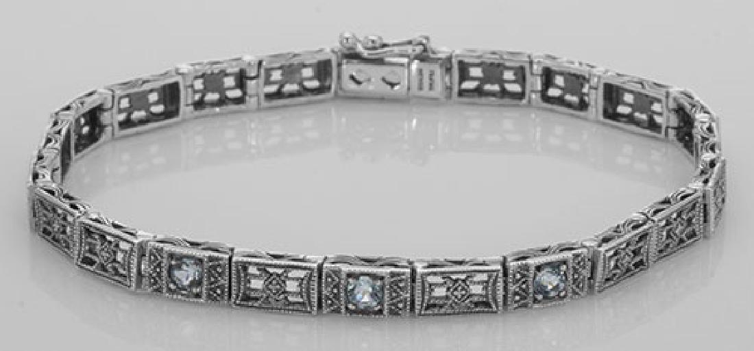 Victorian Style 3 Stone Blue Topaz Filigree Bracelet in