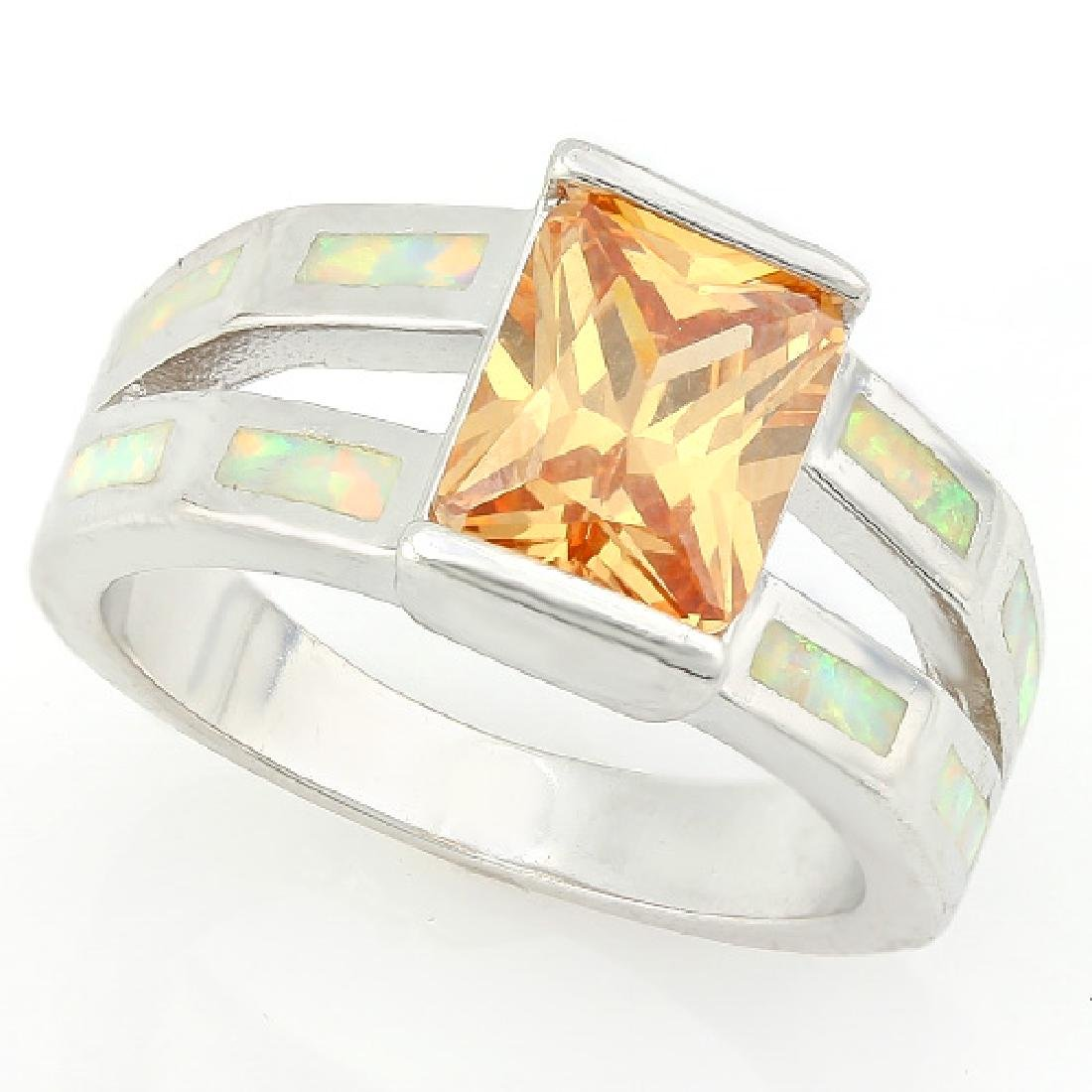 1 1/2 CARAT CREATED ORANGE SAPPHIRE & 2 CARAT CREATED F