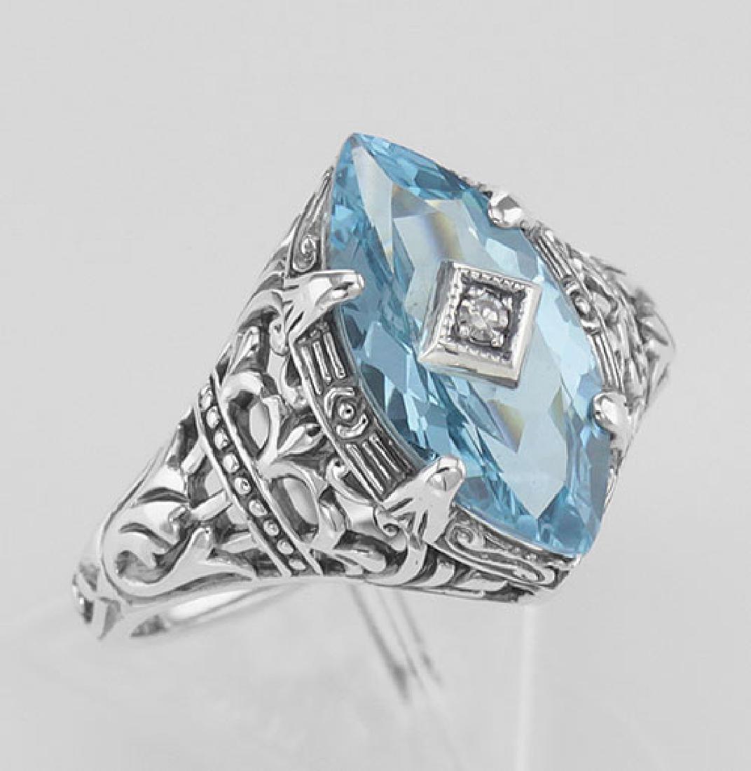Sterling Silver Blue Topaz Filigree Ring w/ Diamond