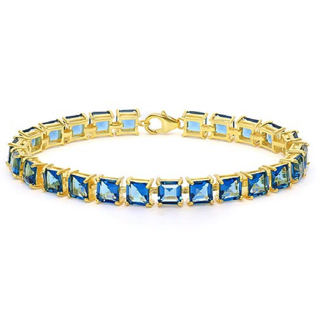 24.1 CTWW NATURAL BLUE TOPAZ 14K GOLD TENNIS BRACELET