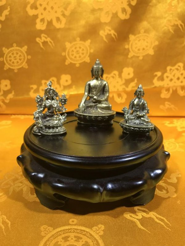 Three small Buddhist Statues.
