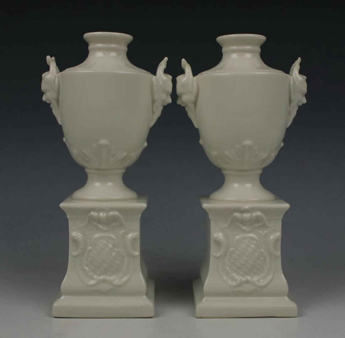 "Nymphenburg pair of ""Satyr Head Urns"""