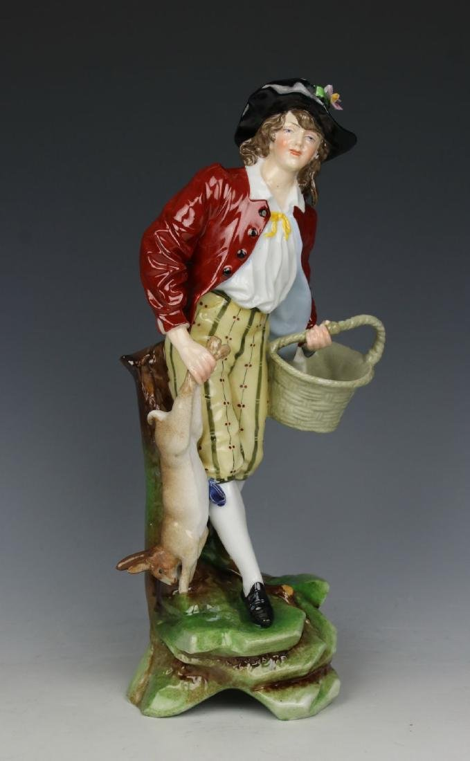 "Antique E&A Muller figurine ""Man with Rabbit"""