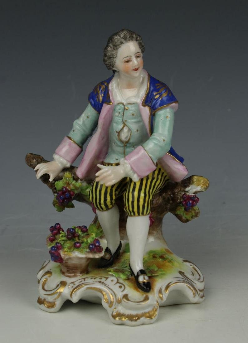 """Dresden Volkstedt figurine """"Sitting Man with Grapes"""""""