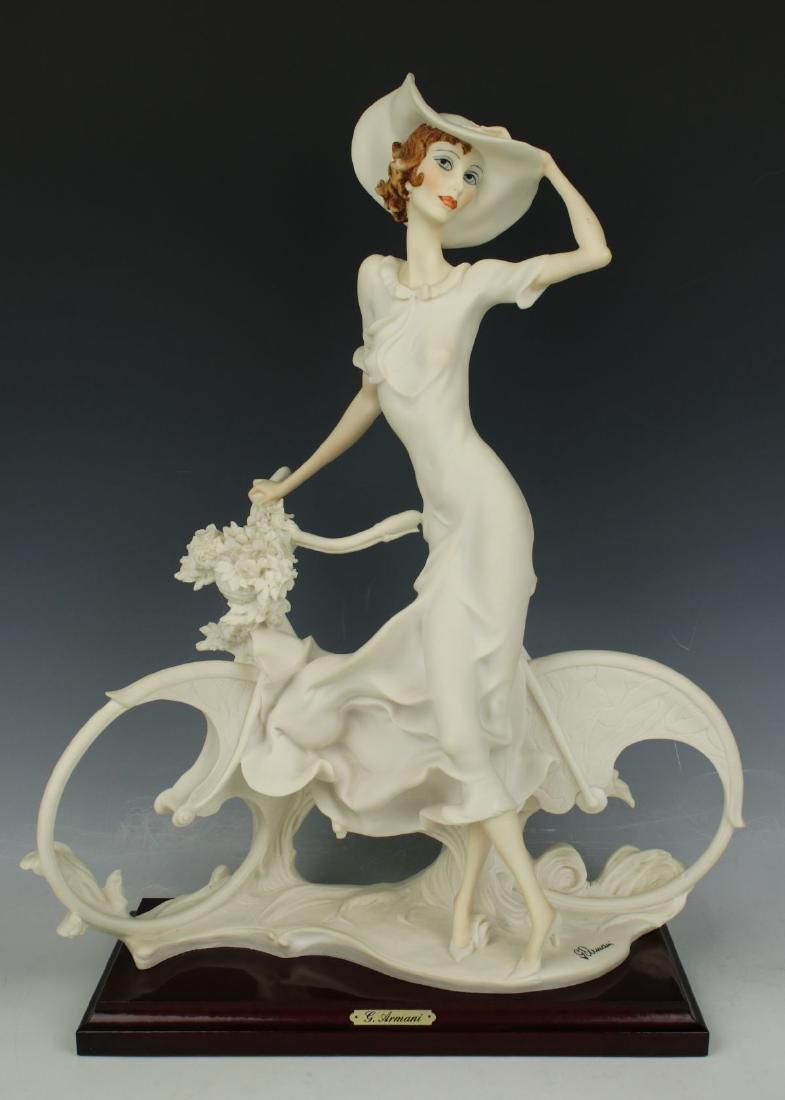 "Giuseppe Armani Figurine Spring ""Lady on Bicycle"""