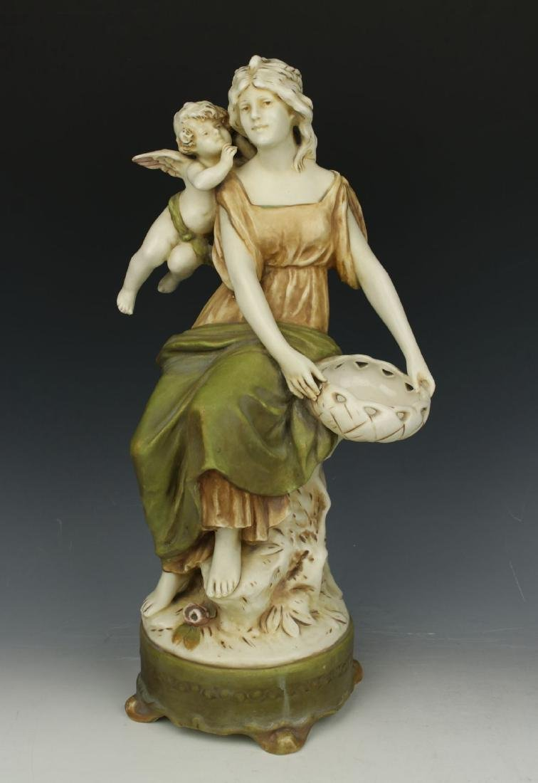 """Royal Dux figurine """"Woman with Cupid"""""""