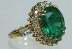 A Ladies 18 Karat Emerald  Diamond Ring