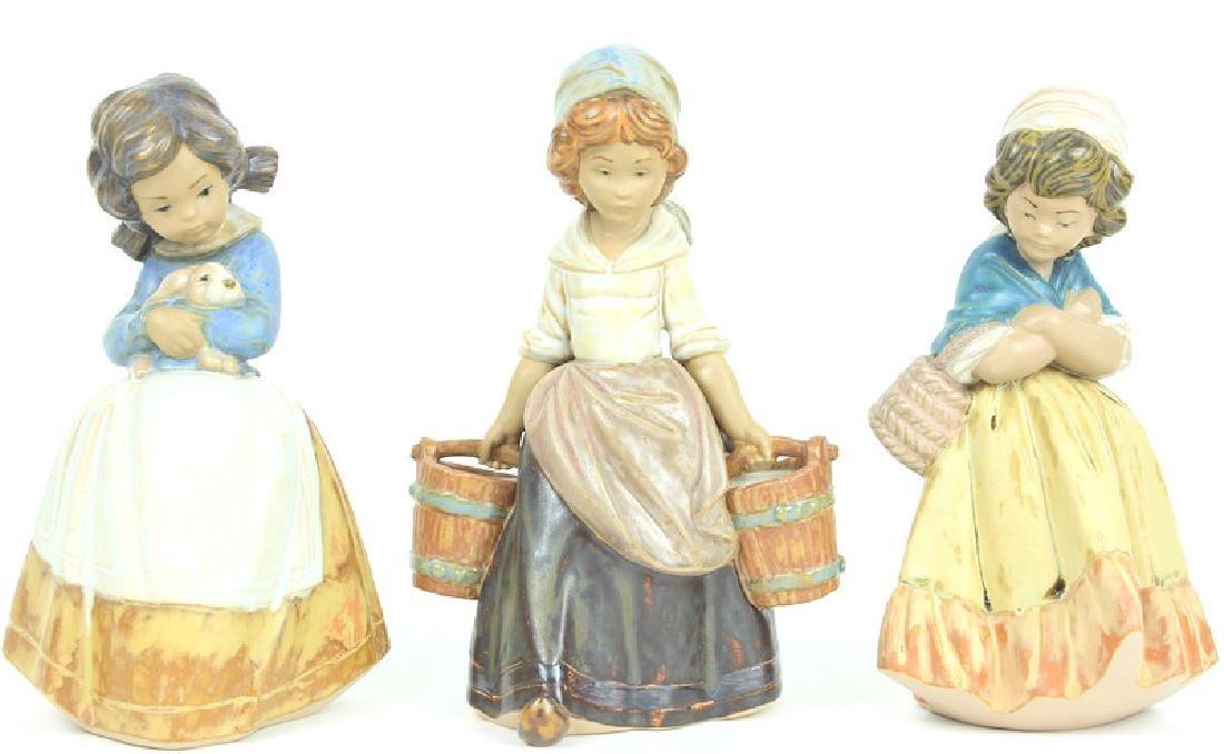 3) THREE LLADRO WOMEN FIGURINES